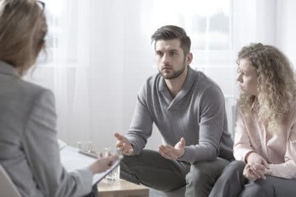 A Man Attending Therapy With His Alcoholic Spouse