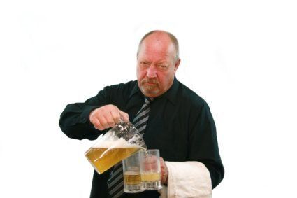 Image of a disgruntled bartender pouring beer into beer mugs, isolated on white.