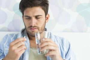 A Man Taking Alcoholism Medications Such As Disulfiram